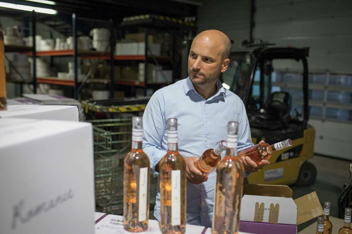 Sebastien Latz, director general of the French wine producer MDCV, inspects bottles of rosA© in a wine production facility in the Chateau des Bertrands vineyard in Le Cannet-des-Maures, in the Provence region, Thursday Oct. 10, 2019. European producers of premium specialty agricultural products like French wine, are facing a U.S. tariff hike on Friday, with dollars 7.5 billion duties on a range of European goods approved by the World Trade Organization for illegal EU subsidies to aviation giant Airbus.(AP Photo/Daniel Cole)