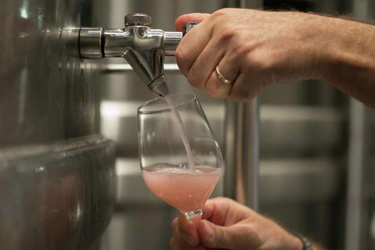 A winemaker pours roseA' at the Chateau Sainte Roseline in the southern France region of Provence, Friday Oct. 11, 2019. European producers of premium specialty agricultural products like French wine, are facing a U.S. tariff hike on Friday, with dollars 7.5 billion duties on a range of European goods approved by the World Trade Organization for illegal EU subsidies to aviation giant Airbus.(AP Photo/Daniel Cole)