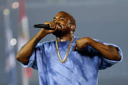 FILE - In this Sunday, July 26, 2015 file photo, Kanye West performs during the closing ceremony of the Pan Am Games, in Toronto. Ikea says Kanye West is visiting the furniture giant's offices in southern Sweden. The company confirmed an online report by Swedish newspaper Aftonbladet Tuesday, March 8, 2016 that the U.S. rapper was in Almhult, the town in southern Sweden where Ikea was founded in the 1940s and where it retains many key operations.