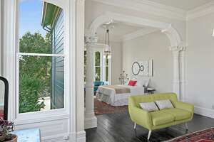 """The 1885 """"DeRome House"""" mansion dominates a magical compound on a flat, spacious lot at 1 076 59th St. in Oakland . The property also includes two remodeled condos."""