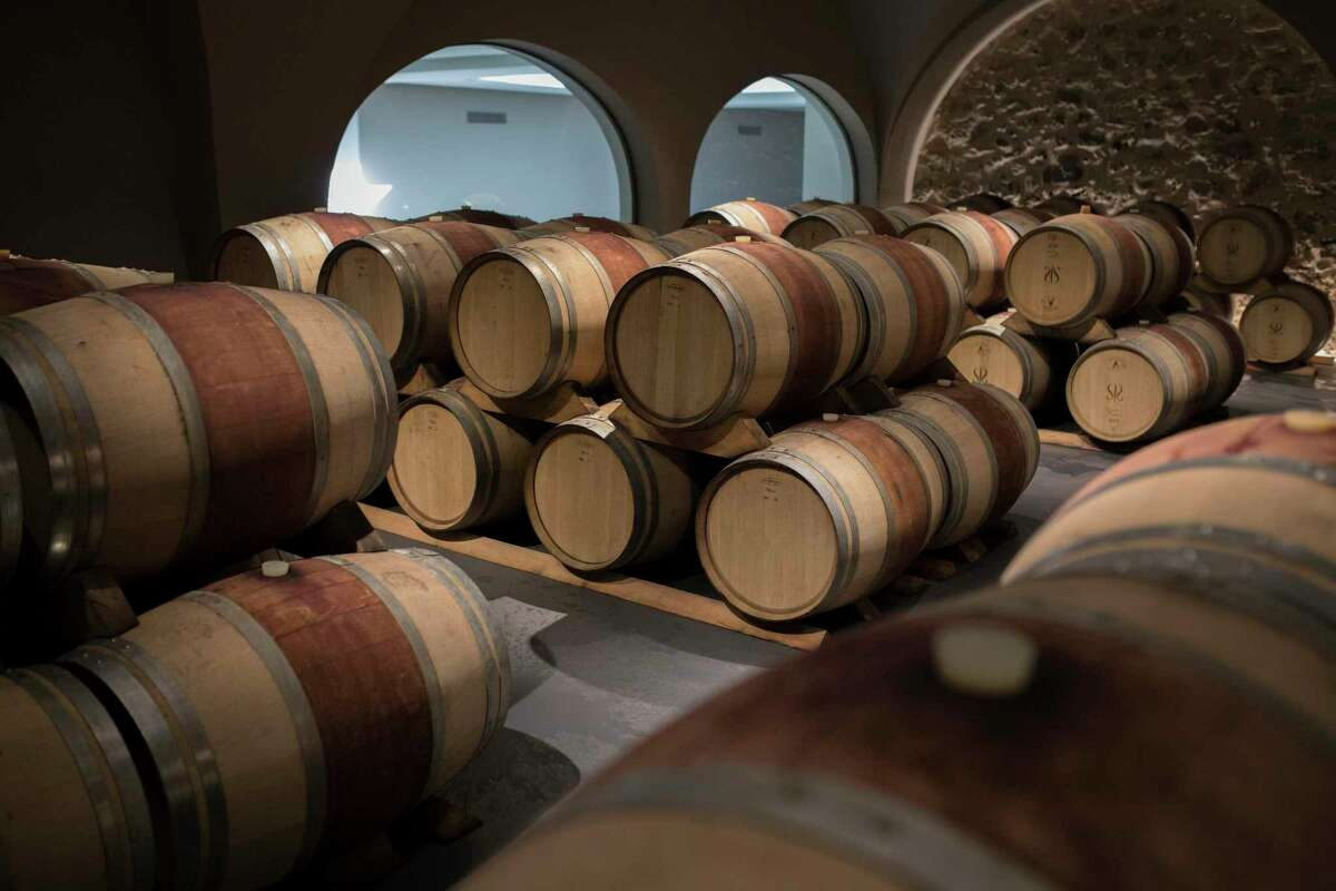 Wine barrels sit in a wine cellar in the southern France region of Provence, Friday Oct. 11, 2019. European producers of premium specialty agricultural products like French wine, Italian Parmesan and Spanish olives are facing Friday's U.S. tariff hike with a mix of trepidation and indignation at being dragged into a trade war over the fiercely competitive aerospace industry. (AP Photo/Daniel Cole)