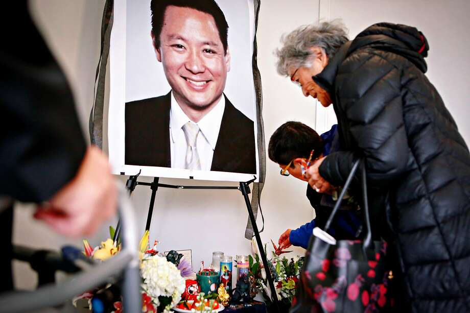 Paul Osaki (left), Teresa Ono and Marjorie Fletcher pay their respects at a memorial for public defender Jeff Adachi in February. Photo: Amy Osborne / Special To The Chronicle