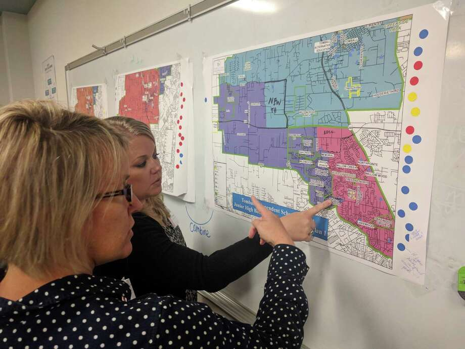 Tomball ISD community members discuss zoning options for two future schools during a District Zone Committee meeting Oct. 17, 2019. Photo: Paul Wedding