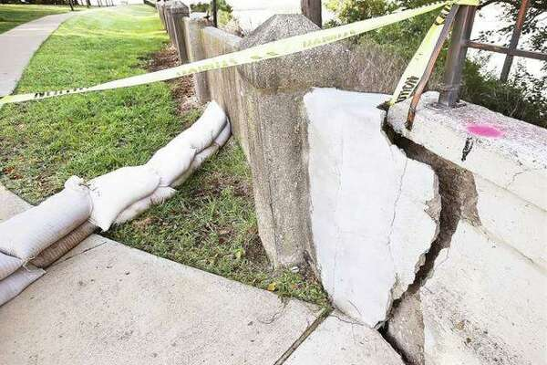 Cracks appeared in the sidewalk along Riverview Drive and in the decorative retaining wall at the edge of Riverview Park's bluff overlook in August after heavy rains.