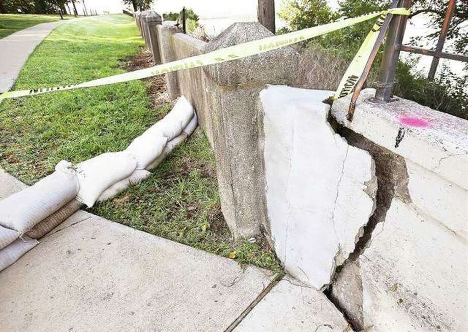 Cracks appeared in the sidewalk along Riverview Drive and in the decorative retaining wall at the edge of Riverview Park's bluff overlook in August after heavy rains. Photo: John Badman|The Telegraph File Photos