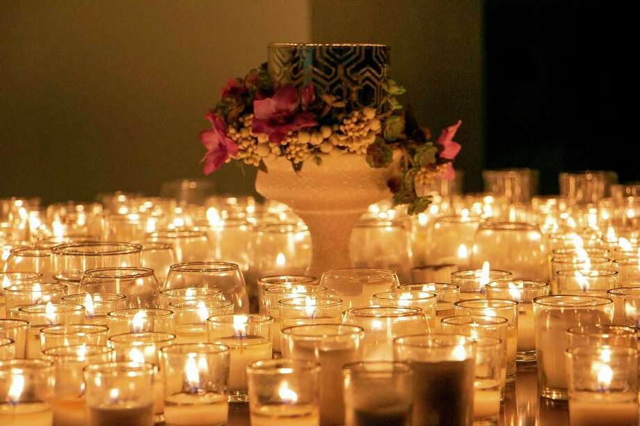 This year was one of the first years in a long time that FamilyTime Crisis and Counseling Center filled their entire table with candles representing those who lost their lives to domestic violence in Texas in 2018. Photo: Savannah Mehrtens/Staff Photo / Savannah Mehrtens/Staff Photo