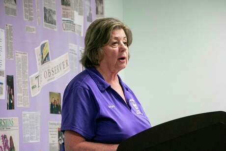 """Judy Cox, executive director of FamilyTime Crisis and Counseling Center, read the poem """"I got flowers today"""" at the candlelight vigil on Oct. 16 to give a description of what the life of a domestic violence victim might be like if nothing is done to help them."""