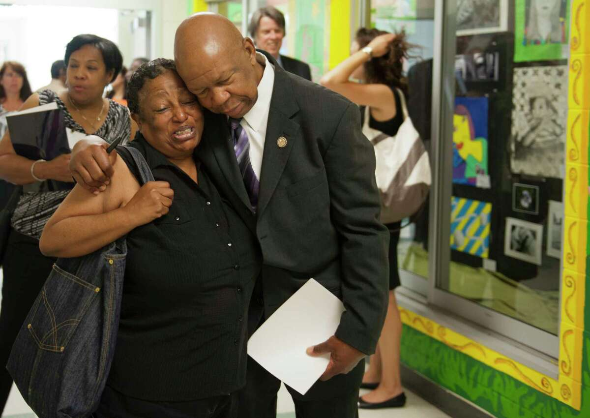 Rep. Elijah E. Cummings, D-Md., (right) receives a hug at a event in Gwynn Oak, Maryland on June 16, 2012.