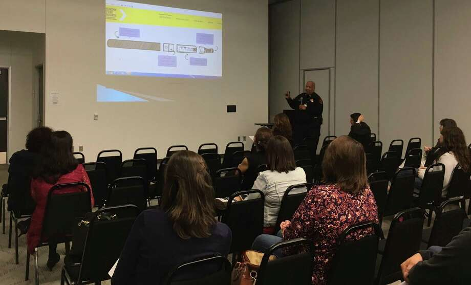Capt. Ivan B. Nelson of the Katy ISD Police Department talked about vaping at the Oct. 16  Legacy Parents Academy. Here he talks about the components of e-cigarettes: a mouthpiece, a cartridge, a heating element/atomizer and a battery. Photo: Karen Zurawski / Karen Zurawski