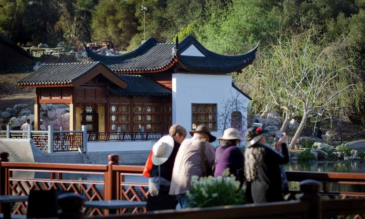 Visitors enjoy the view of the newly completed Waveless Boat Pavilion on the west side of the Lake of Reflected Fragrance at the Huntington Chinese Garden on February 19, 2014 inside the Huntington Library, Art Collections, and Botanical Gardens in San Marino, California. The pavilion is part of the second phase of the Chinese garden which opens in early March. (Gina Ferazzi/Los Angeles Times/TNS)