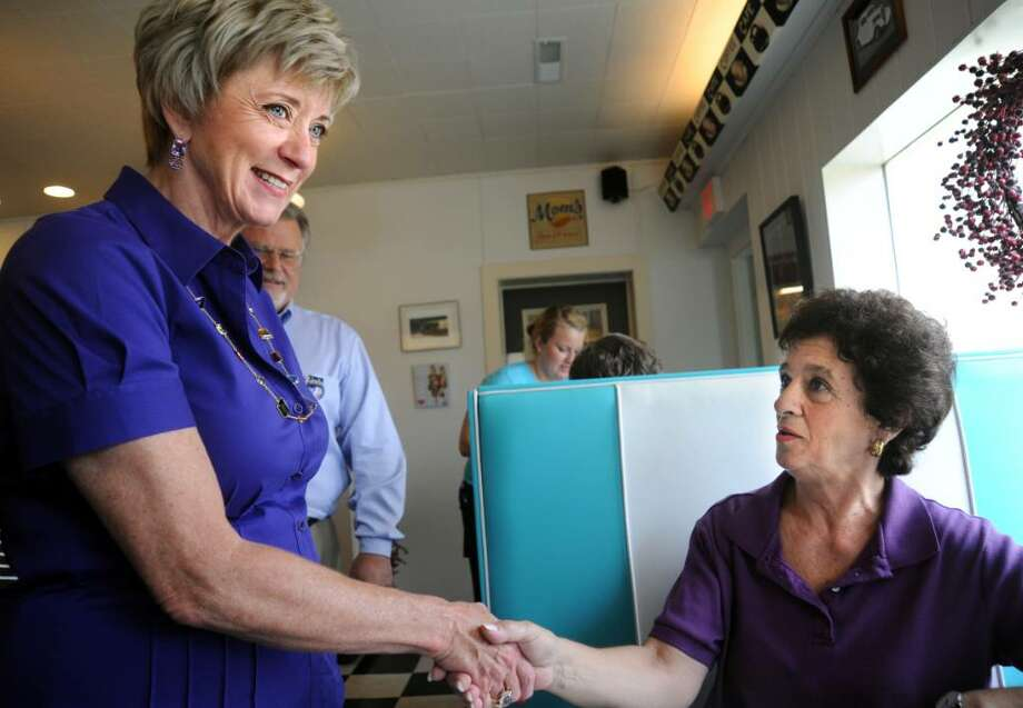 Republican US Senate candidate Linda McMahon introduces herself to Carolyn Zachary, of Cheshire, during a campaign stop at Dottie's Diner in Woodbury Wednesday August 4, 2010. Photo: Autumn Driscoll / Connecticut Post