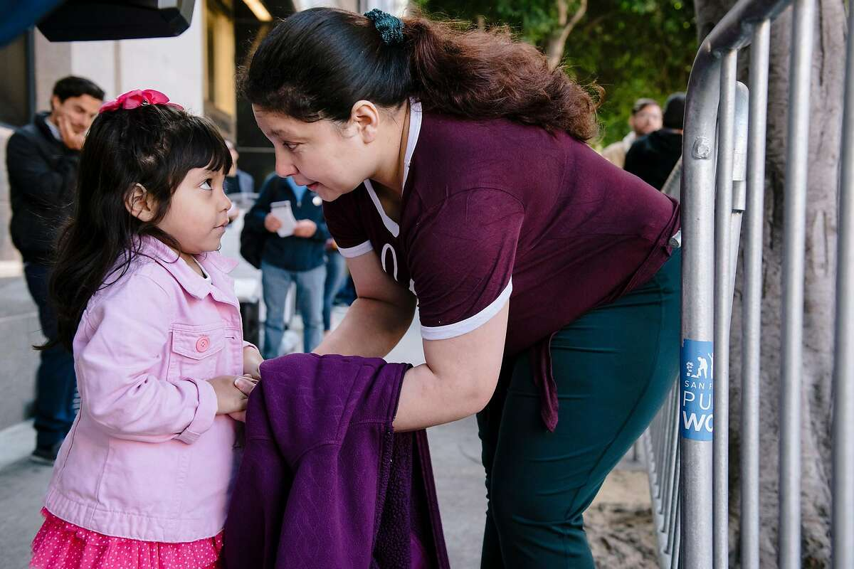 Aida Andrade Amaya, bends down to speak with her four year old daughter Jade during a rally by immigrant rights supporters outside of Immigration and Customs Enforcement's headquarters in San Francisco, California, on Thursday, Oct. 17, 2019. Lawyer Jehan Romero, of Pangea Legal Services filed a lawsuit on behalf of her client Aida Andrade Amaya against Immigration and Customs Enforcement and U.S. Attorney General Willian Barr, arguing that Aida's detention was unjust and illegal after she was kept in ICE detention for several months even after winning her asylum case earlier this year.