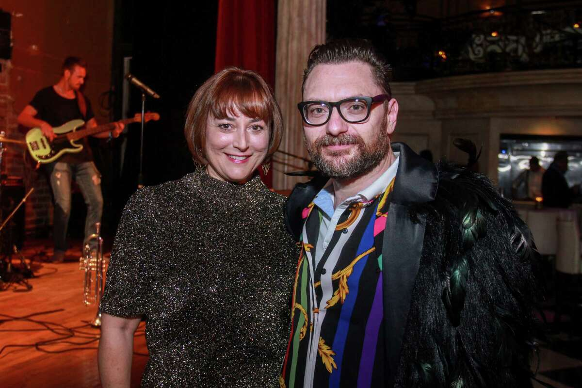 Board chair Leigh Smith, and John Abodeely at the Houston Arts Alliance's Immerse cocktail reception showcasing a number of local performers and artists at the Prohibition Theatre on October 16, 2019.