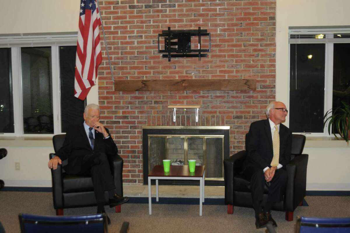 Dick Moccia, left, the Republican candidate for first selectman, sits next to Ridgefield First Selectman Rudy Marconi during a forum at Ballard Green on Tuesday, Oct. 15.