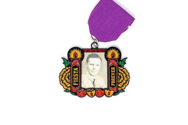 """Six months stand between the city and the biggest celebration, but San Antonio Flavor Manufacturer Garrett Heath figured Día de los Muertos would be the perfect time to release the """"Ofrenda Medal."""" Heath said Ray Linares approached him with the idea to create a Fiesta medal for 2020 designed as a condensed version of an ofrenda, displays decorated during the Mexican holiday to honor the dead.What's unique about the just-released pin is the capability for customization. Fiesta fans can slip a wallet-sized photo of their departed loved one into the medal, much like a locket."""