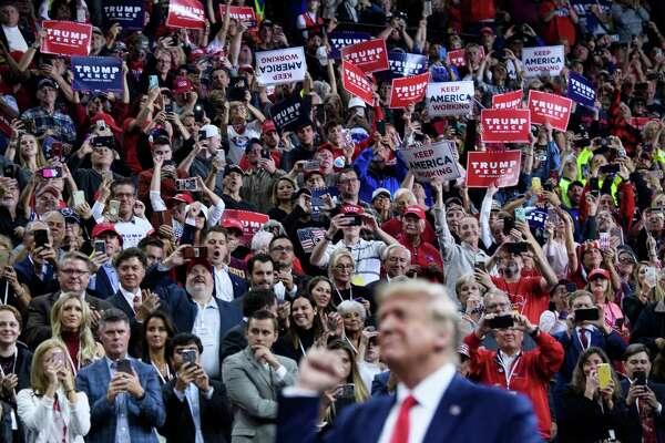 """President Donald Trump attends a """"Keep America Great"""" rally at the Target Center in Minneapolis, Minnesota on Oct. 10. An internet meme that depicts Donald Trump shooting and stabbing media characters and political opponents was shown at a conference for his supporters, the New York Times reported on Oct. 13."""