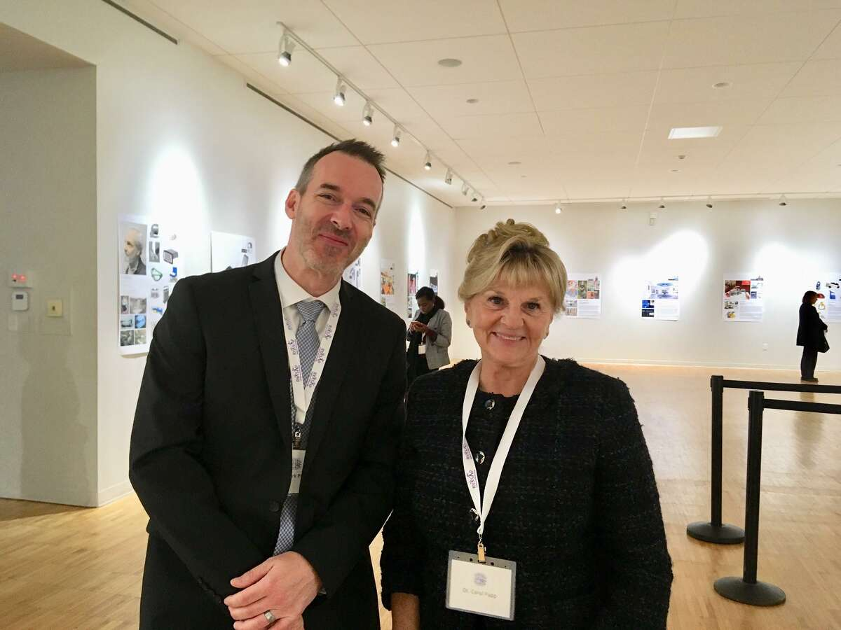 Mark Pitcher, UB director of Health Sciences Inter-Professional Research. and Carol Papp, dean of UB College of Health Sciences, hosts of UB's inaugural health care symposium. Bridgeport. October 17, 2019