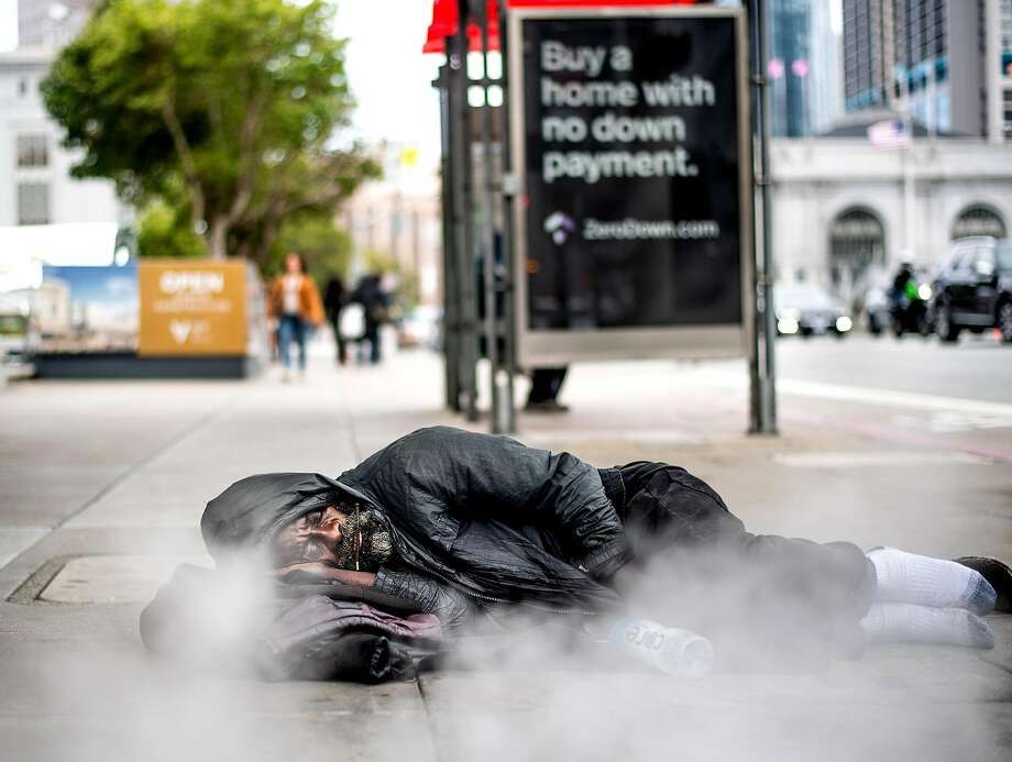 Ronnie Dixson, who says he's been homeless for 30 years, sleeps by a steam vent in front of the Asian Art Museum in June. Photo: Noah Berger / Special To The Chronicle
