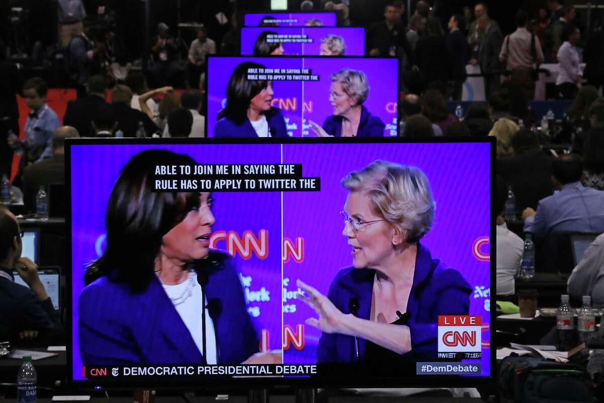 WESTERVILLE, OHIO - OCTOBER 15: Sen. Kamala Harris (D-CA) and Sen. Elizabeth Warren (D-MA) appear on television screens in the Media Center as they go back and forth during the Democratic Presidential Debate at Otterbein University on October 15, 2019 in Westerville, Ohio. A record 12 presidential hopefuls are participating in the debate hosted by CNN and The New York Times. (Photo by Chip Somodevilla/Getty Images)