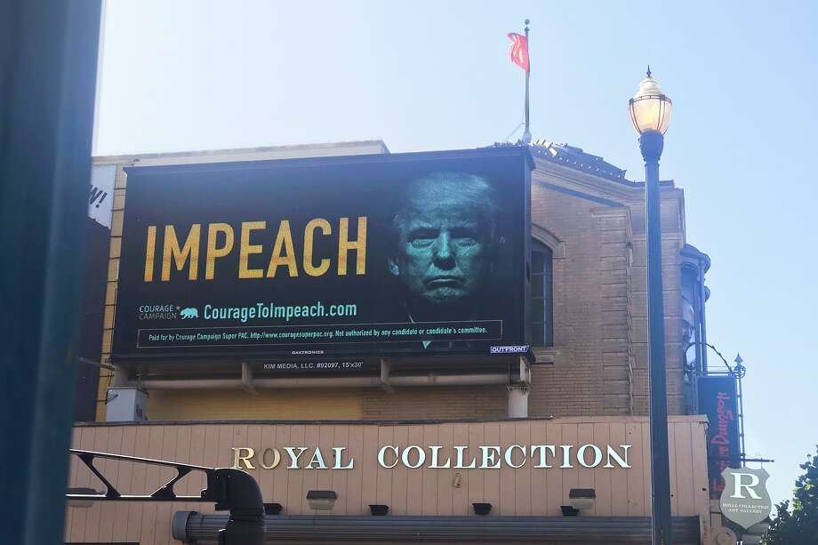 Among the sea lions, crab cocktails and swarms of tourists in San Francisco's Fisherman's Wharf neighborhood, a massive billboard featuring a steely-looking President Donald Trump popped up on Tuesday. Photo: Devon Chulick