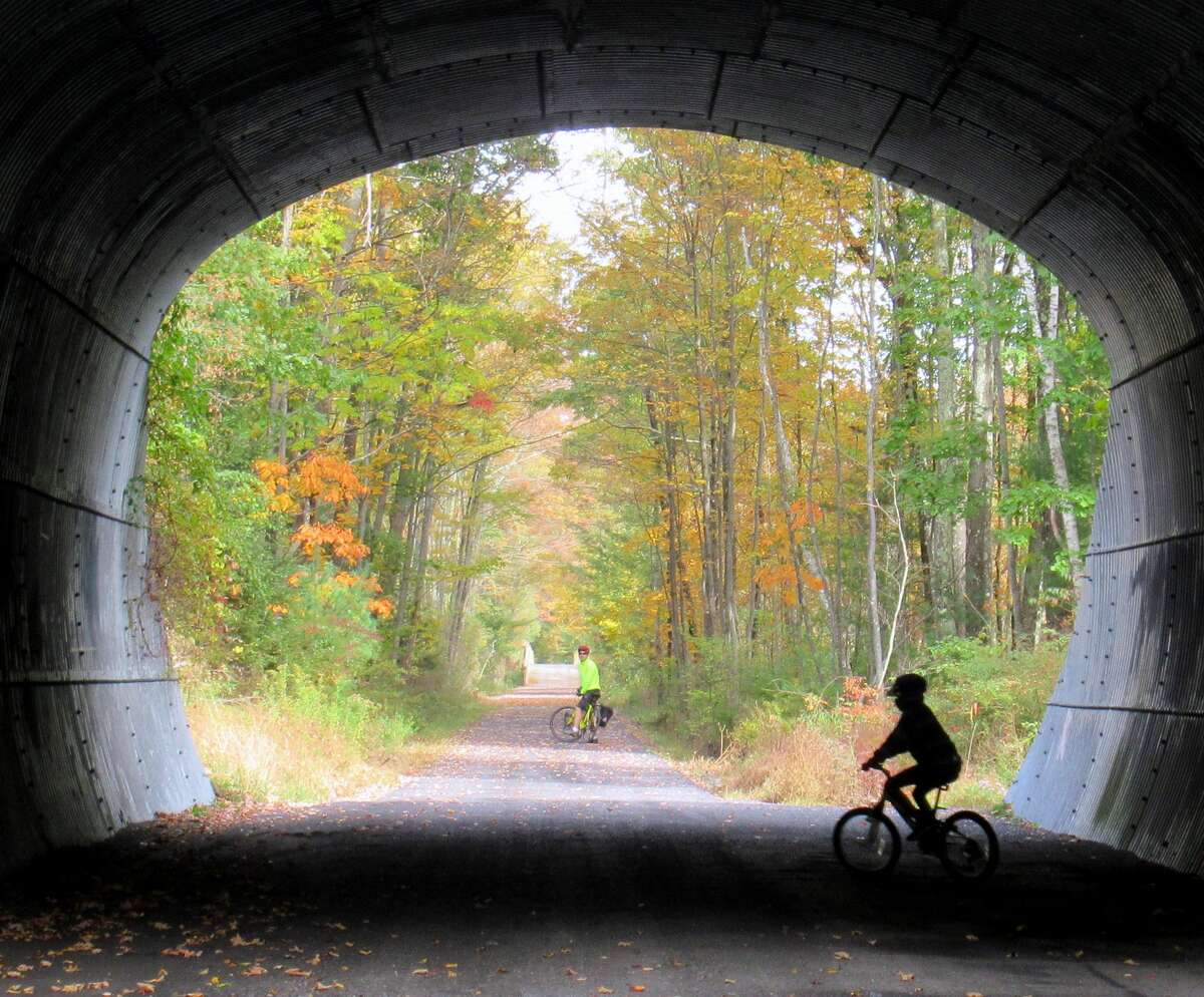 A train-sized tunnel takes riders under a road on the Ashokan Rail Trail. (Gillian Scott / Special to the Times Union)
