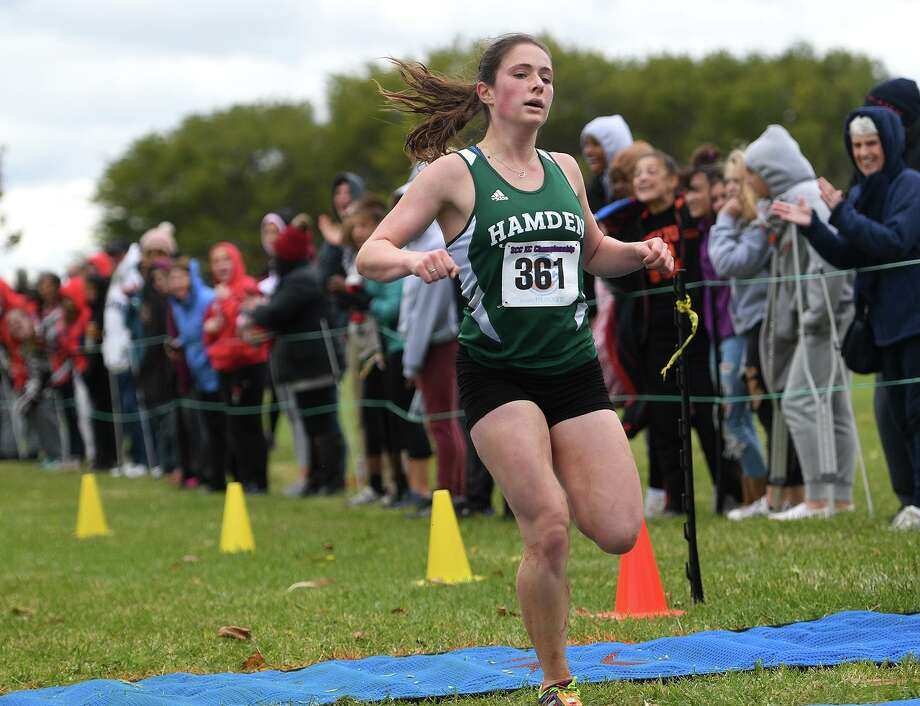 Hamden's Ella Bradford races to victory at the SCC Cross Country Championships at East Shore Park in New Haven on Thursday. Photo: Brian Pounds / Hearst Connecticut Media / Connecticut Post