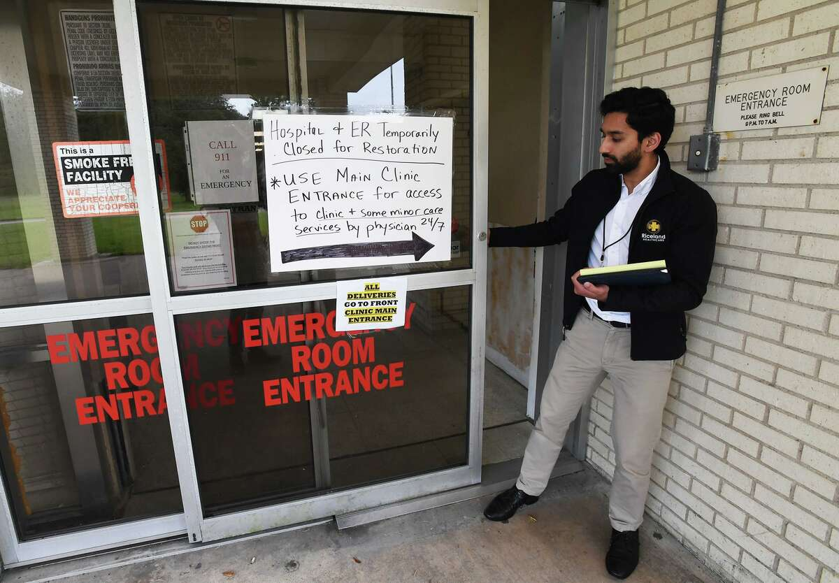 Saad Javed administrator at Riceland Medical Center in Winnie is seen by a closed sign on the emergency room door Thursday. While patients are being seen in the facility's clinic, the hospital section has been closed from Tropical Depression Imelda damage. Javed said he hopes to return to regular operations within a few weeks. Photo taken Thursday, 10/17/19