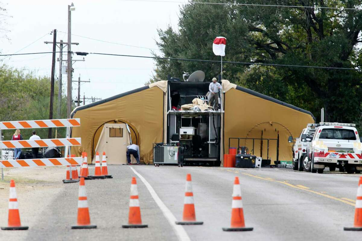 Workers tear town an emergency operation center by the Sutherland Springs, Texas First Baptist Church, Thursday, Nov. 9, 2017. On Sunday, Devin Patrick Kelley, 26, walked in on worshippers and killed 26 women, children and men, injuring 20 others.