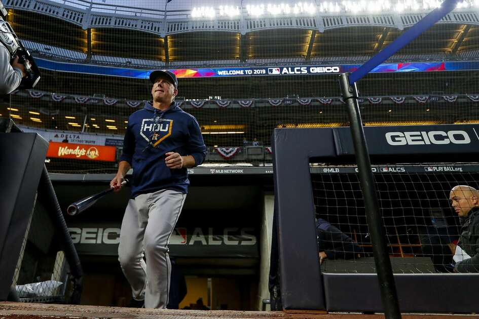 Houston Astros manager AJ Hinch (14) takes the field for batting practice before Game 4 of the American League Championship Series at Yankee Stadium on Thursday, Oct. 17, 2019, in New York.
