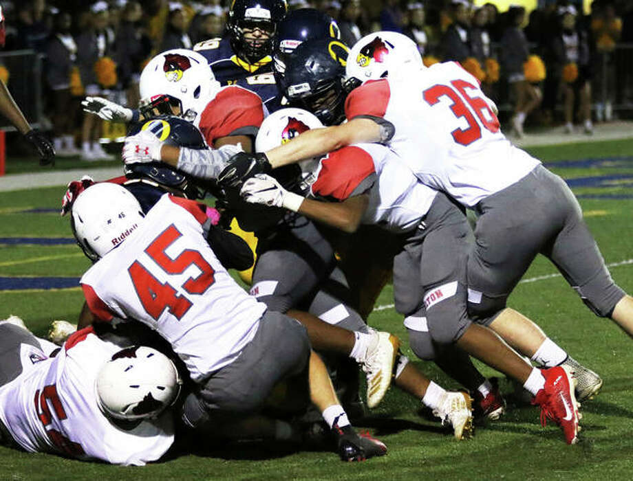 Alton kickoff unit stacks up O'Fallon's return inside the 5-yard line during a Redbirds' SWC victory Oct. 4 in O'Fallon. The Redbirds close SWC play Friday at Belleville West before returning home for a Week 9 game vs. DeKalb. Photo: Greg Shashack / The Telegraph