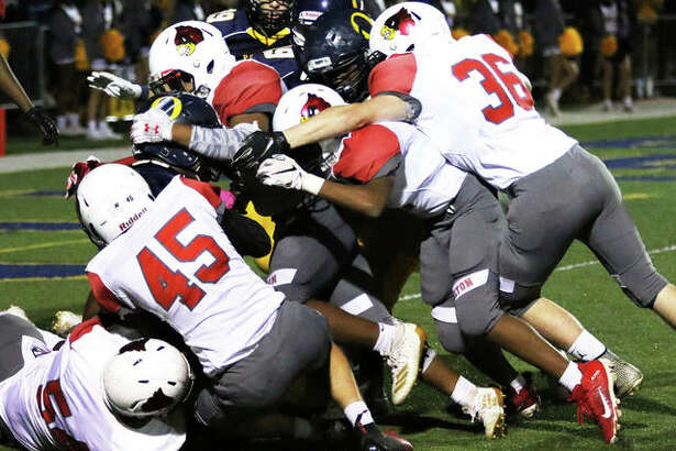Alton kickoff unit stacks up O'Fallon's return inside the 5-yard line during a Redbirds' SWC victory Oct. 4 in O'Fallon. The Redbirds close SWC play Friday at Belleville West before returning home for a Week 9 game vs. DeKalb.