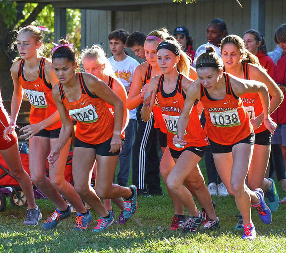 Members of the Edwardsville girls cross country team gets off to a quick start in the Southwestern Conference Meet at Gordon Moore Park. Photo: Matt Kamp|The Intelligencer