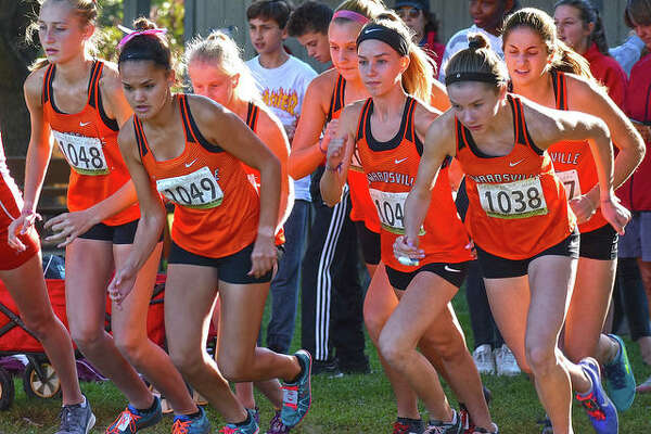 Members of the Edwardsville girls cross country team gets off to a quick start in the Southwestern Conference Meet at Gordon Moore Park.