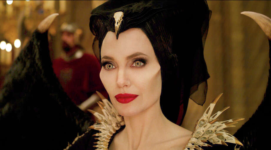 """This image released by Disney shows Angelina Jolie as Maleficent in a scene from """"Maleficent: Mistress of Evil."""" (Disney via AP) / © 2019 Disney Enterprises, Inc. All Rights Reserved."""