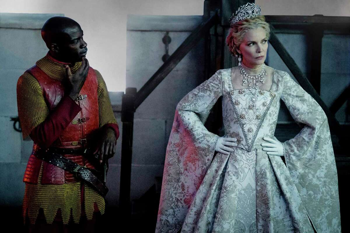 This image released by Disney shows David Gyasi, left, and Michelle Pfeiffer as Queen Ingrith in a scene from