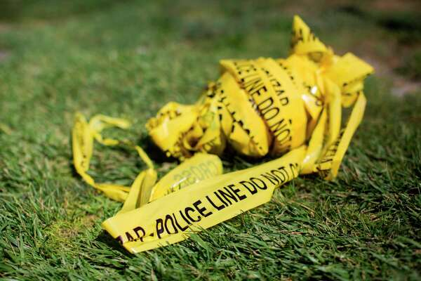 (FILES) In this file photo taken on August 8, 2019 a bundle of police crime scene tape is left on front of the 7-eleven shop in Santa Ana, California where a security guard was fatally stabbed. - Violent crime in the United States fell for a second straight year in 2018, underscoring a long-term downward trend that was briefly interrupted by an uptick in 2015 and 2016, the FBI said on September 30, 2019. The Federal Bureau of Investigation said there were some 1.2 million violent crimes in 2018, down 3.3 percent from the year before. Homicides were down 6.2 percent from 2017, with 16,214 murders, almost three quarters of which were committed with a firearm. (Photo by Apu Gomes / AFP)APU GOMES/AFP/Getty Images