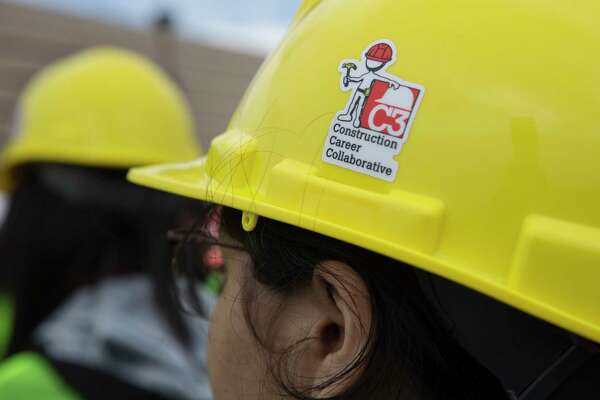 Nimitz High School 10th-grader Joselyn Toledo wears a construction hard hat at the She Builds Houston, a conference for middle and high school students aimed at encouraging girls to join the construction industry, at M.O. Campbell Educational Center on Thursday, Oct. 17, 2019, in Houston. More than 1,000 girls from the Aldine ISD participated the conference.