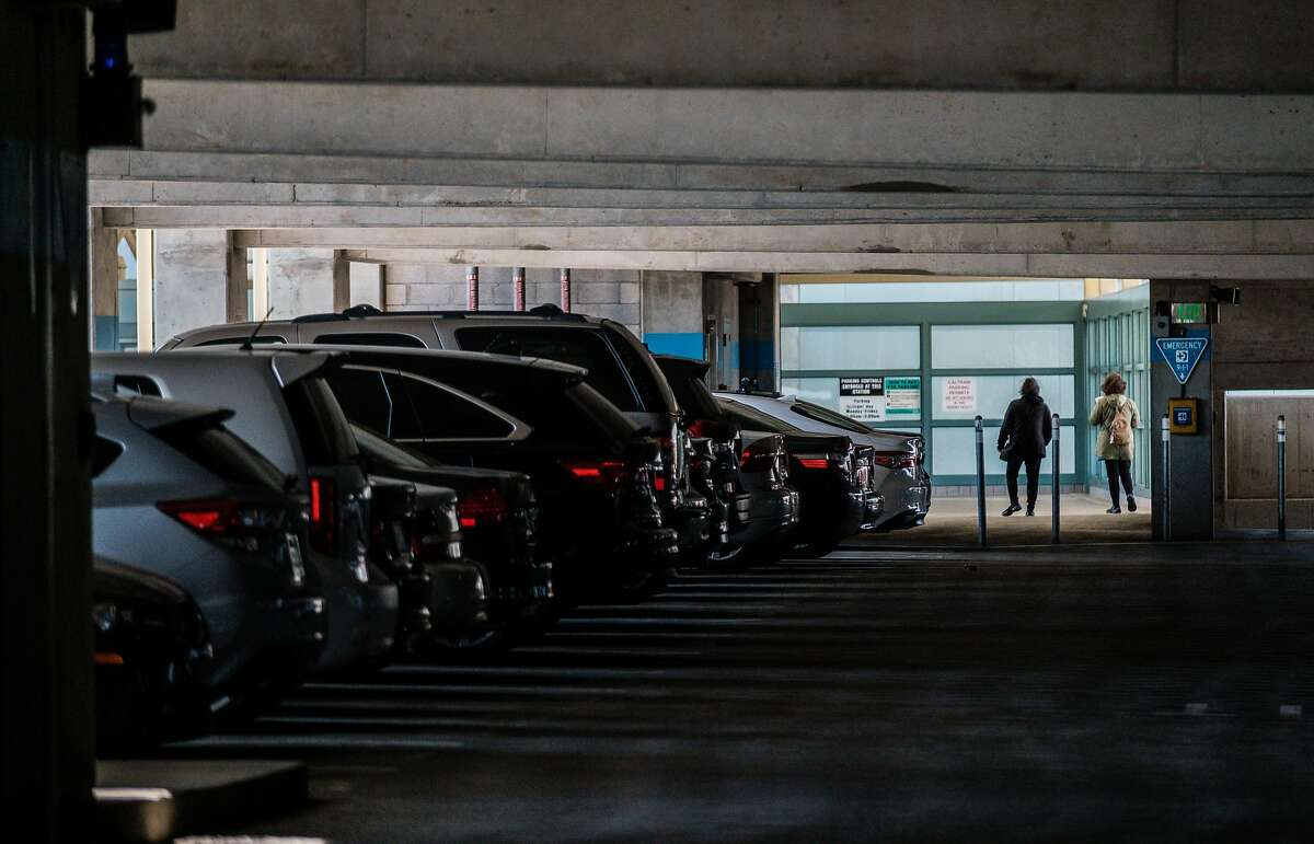 People exit the parking structure at the BART Millbrae Station in Millbrae, Calif. on Thursday, October 16, 2019. BART is preparing to launch an ambitious plan which will see much of the transit agency's dedicated parking lots shrunken or eliminated to become sites of high-density housing.