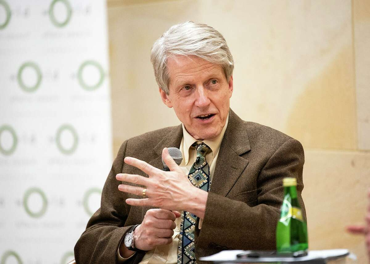 """Yale University economist Robert Shiller, winner of the Nobel Prize in 2013, says narratives from the coronavirus crisis could lead to measures to reduce income equality. He talked about the role of narrative storytelling in the economy at the Mark Twain House in Hartford on Wednesday, Oct. 16, 2019. Shiller's most recent book is """"Narrative Economics: How Stories go Viral and Drive Major Economic Events."""""""