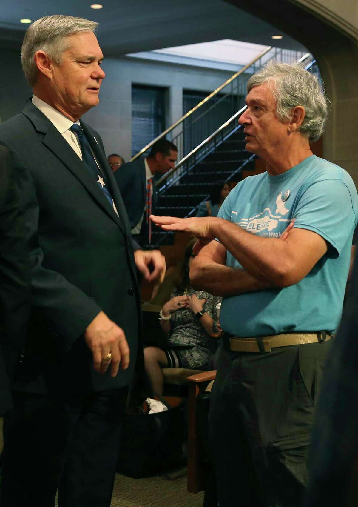 Climate Action and Adaptation Plan supporter Alan Montemayor, right, speaks with San Antonio City Council District 10 member Clayton Perry before the start of the council's regular meeting, Thursday, Oct. 17, 2019. The council voted 10-1 to pass the plan. Perry was the lone vote against it.