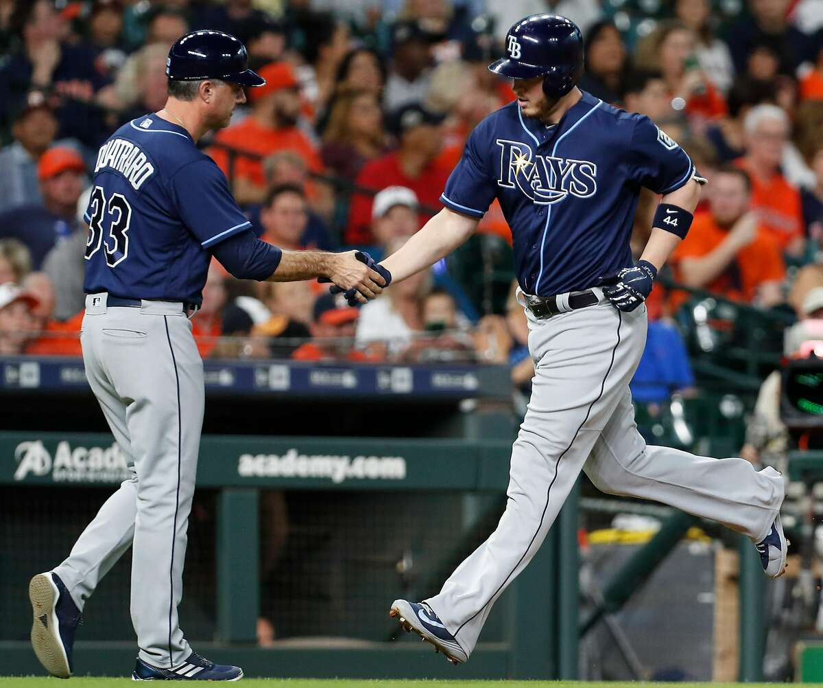 Tampa Bay Rays designated hitter C.J. Cron (44) rounds third base past third base coach Matt Quatraro (33) after hitting a solor home run off Houston Astros starting pitcher Justin Verlander during the second inning of a major league baseball game at Minute Maid Park on Tuesday, June 19, 2018, in Houston. ( Brett Coomer / Houston Chronicle )