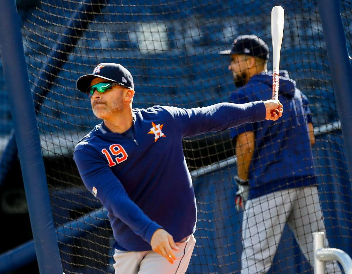 Houston Astros bench coach Joe Espada (19) hits balls while warming up his team before Game 3 of the American League Championship Series at Yankee Stadium in New York on Tuesday, Oct. 15, 2019.