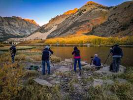 Photographer line up to take photographs of the North Lake of the North Fork of Bishop Creek Canyon in Inyo County by Philip Reedy.