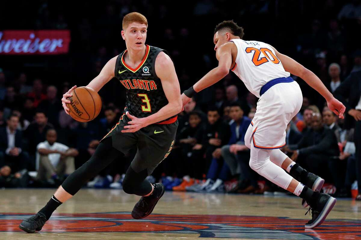 Atlanta Hawks guard Kevin Huerter (3) drives to the basket past New York Knicks forward Kevin Knox during the first half of an NBA basketball game Friday, Dec. 21, 2018, in New York. The Hawks won 114-107. (AP Photo/Adam Hunger)