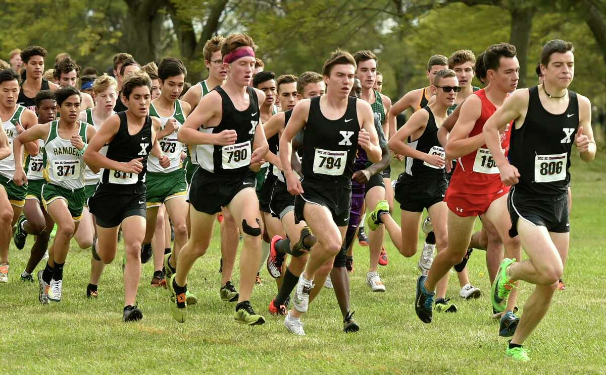 New Haven, Connecticut - Thursday, October 17, 2019: 9th place finisher George Luke of Xavier H.S., right, leads the pack followed by 2nd place finisher Brendan Mellitt of Cheshire H.S., second from right, first place finisher Robbie Cozean of Xavier H.S. wearing bib number 794 and 7th place finisher Eamon Burke of Xavier H.S. wearing bib number 790 at the start of The SCC Boys Cross Country Championship Thursday afternoon at East Shore Park in New Haven.