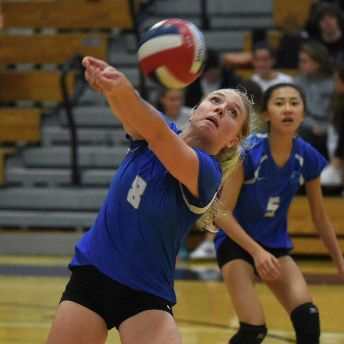 Darien's Elaina Cummiskey (8) keeps the ball alive during the Wave's volleyball match with New Canaan at Darien High School on Thursday, Oct. 17, 2019