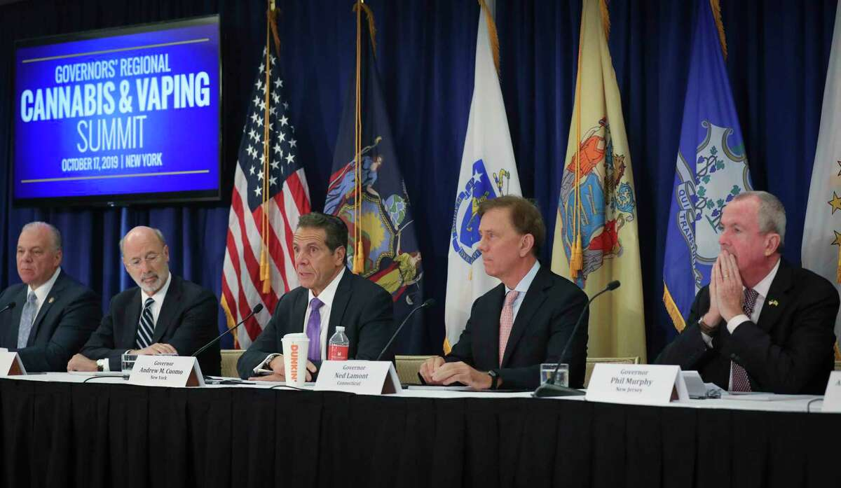Pennsylvania Gov. Tom Wolf, second from left, New York Gov. Andrew Cuomo, center, Connecticut Gov. Ned Lamont, second from right, and New Jersey Gov. Phil Murphy, far right, co-host a regional summit on public health issues around cannabis and vaping, Thursday Oct. 17, 2019, in New York. (AP Photo/Bebeto Matthews)