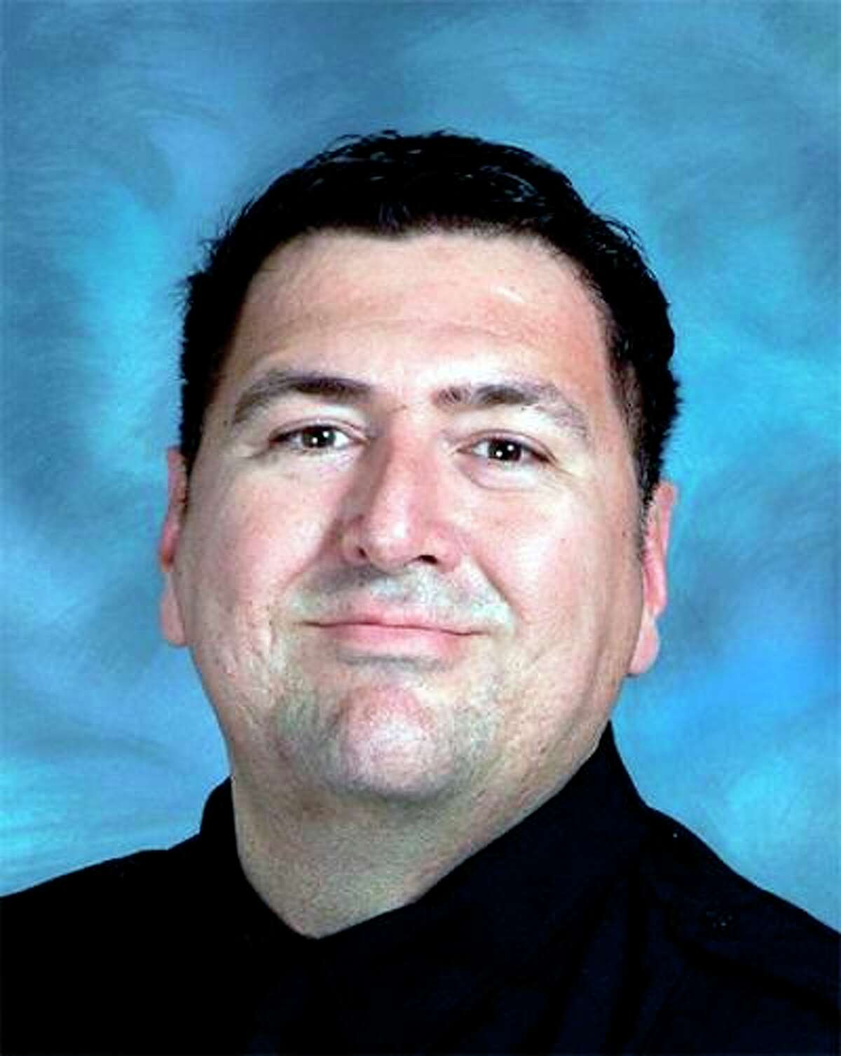 Firefighter Greg Garza, a 17-year veteran of the San Antonio Fire Department, died after being struck by a van early Tuesday. Garza, 49, had responded to a report of an electrical fire at a downtown hotel.