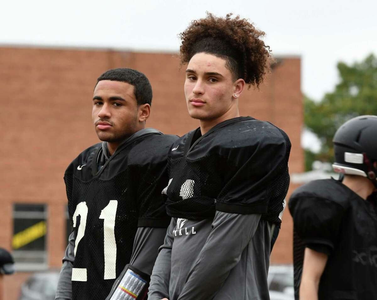 Holy Trinity football receivers, Nacier Hundley, left, and Noah Foster, right, stand for a photo during practice on Wednesday, Oct. 16, 2019, in Schenectady, N.Y. (Will Waldron/Times Union)
