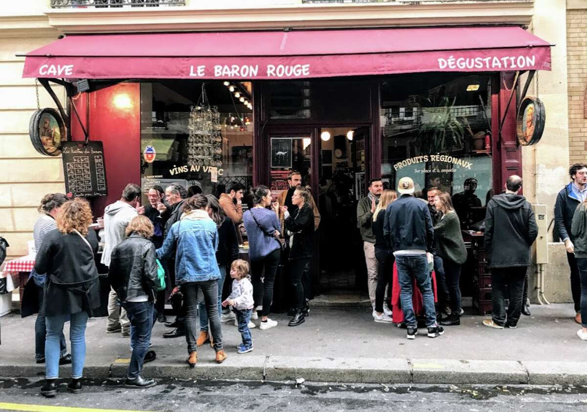 On warm winter days in Paris, locals stand outside for fresh oysters and Sancerre at the Baron Rouge
